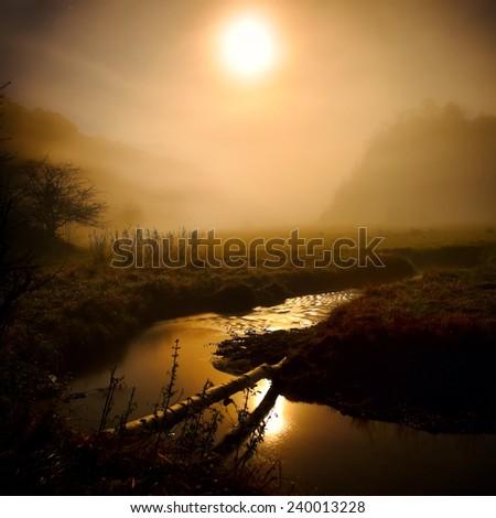 mountain landscape in autumn by night - Fundatura Ponorului, Romania - stock photo