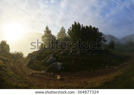 mountain landscape in summer morning with fog, Romania, Fundatura Ponorului