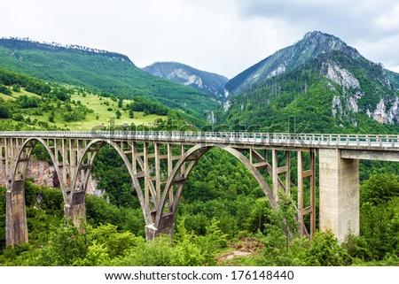 Mountain landscape, Montenegro. Durdevica Tara arc bridge in the mountains, One of the highest automobile bridges in Europe. - stock photo