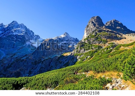 Mountain landscape. Picturesque view over high peaks in Tatra mountains in autumn season. - stock photo