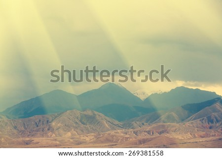 Mountain landscape, storm clouds - instagram style - stock photo
