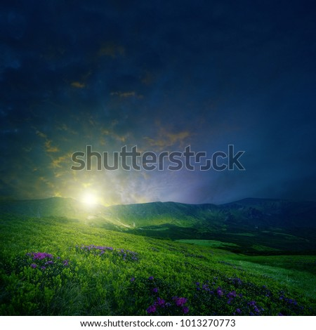 Mountain landscape toned with surreal colors of sunrise