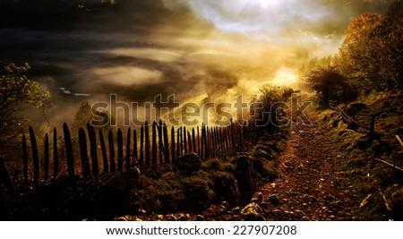 mountain landscape with autumn morning fog at sunrise - Fundatura Ponorului, Romania - stock photo