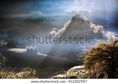 mountain landscape with autumn morning fog at sunrise - Romania