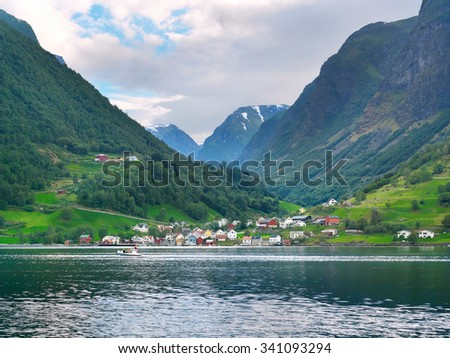 Mountain landscape with colourful fishing village of Sognefjord. Norway - stock photo