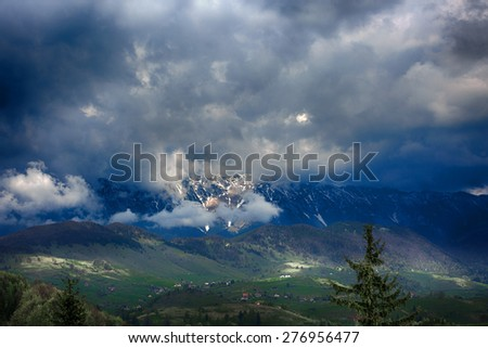 mountain landscape with dramatic rain clouds