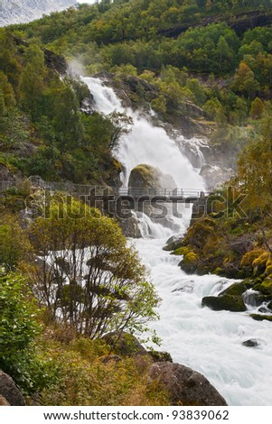 Mountain landscape with falls Kleivafossen in Norway