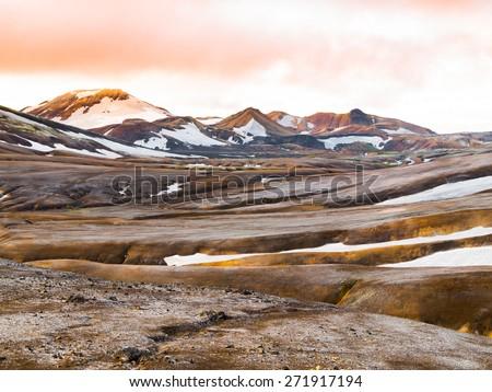 Mountain landscape with fields of snow, Landmannalaugar, Rainbow mountains, Iceland - stock photo