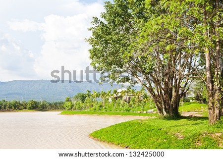 Mountain landscape with lake and sky - stock photo