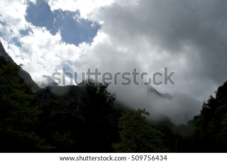 Mountain landscape with peaks covered by clouds, Taygetos mountain range