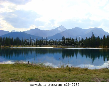 Mountain landscape with reflections in a calm pond