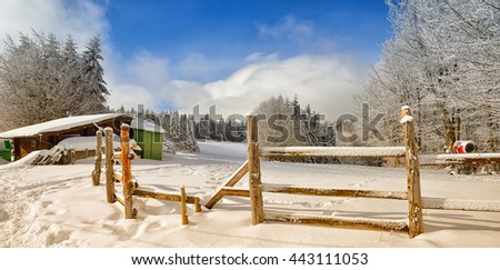 mountain landscape with refuge in the snow in winter