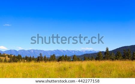 Mountain landscape with Rocky Mountain peaks. - stock photo