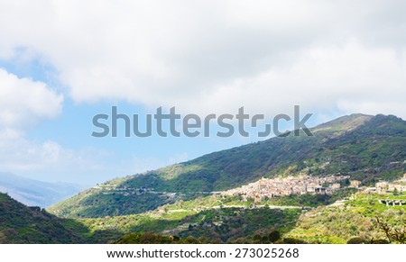 mountain landscape with Savoca village in Sicily in spring - stock photo