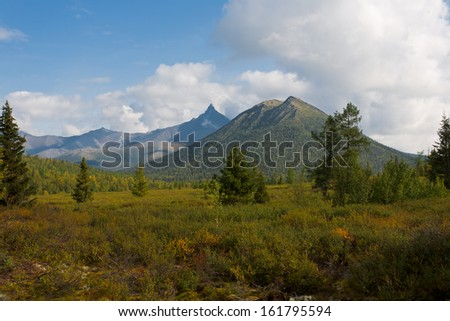 Mountain landscape with sky and clouds, Ural Mountains, Russia.