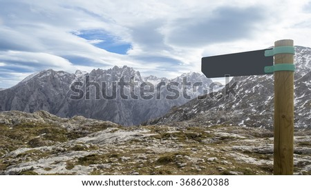 Mountain landscape with snow and Blank footpath signposts leading to one direction. Copy space ready to be filled with text. Conceptual leading indicator.