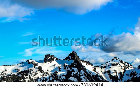 Mountain landscape with snow and blue sky