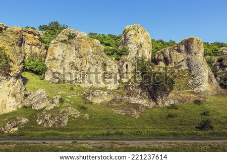 Mountain landscape with some of the oldest limestone rock formations in Europe, dating back to Mesozoic period, in Dobrogea Gorges (Cheile Dobrogei), Romania. - stock photo