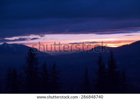 Mountain landscape with sunset and pine trees in Zakopane - stock photo