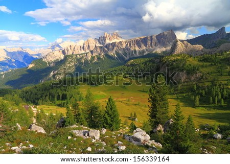 Mountain landscape with vivid meadow and distant summits, Dolomite Alps, Italy - stock photo