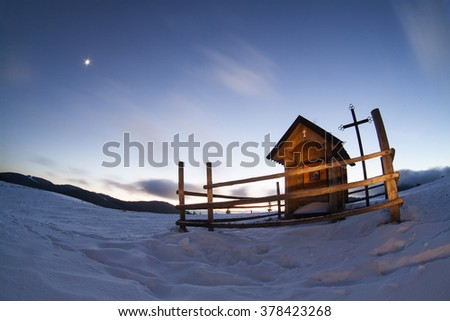 Mountain landscape with wooden villages. Winter evening. The path in the snow. Carpathians, Ukraine, Europe