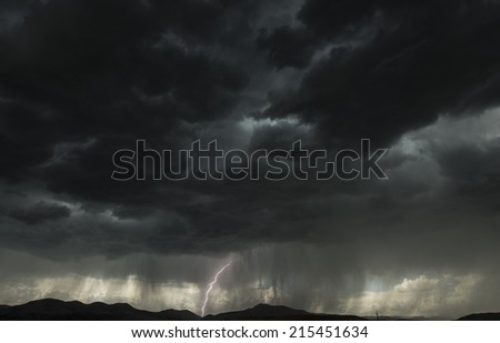Mountain Lightning Bolt. Lightning Strike in the Colorado Mountains. Stormy Weather. - stock photo