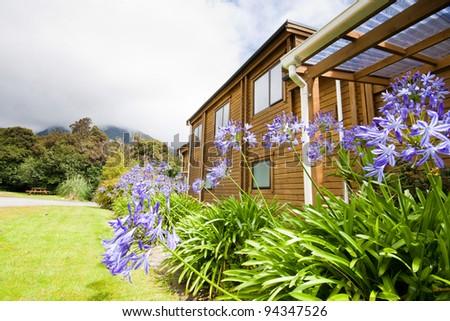 Mountain lodge exterior. Fox Glacier Lodge, Fox Glacier, West Coast, South Island, New Zealand. - stock photo