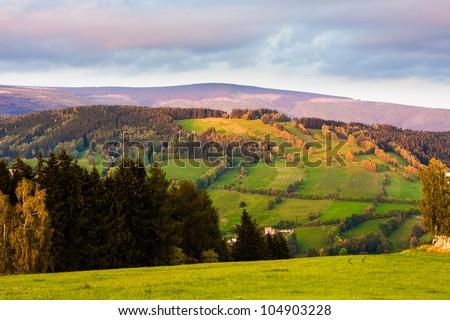 Mountain meadows at sunset (Krkonose, Czech Republic) - stock photo