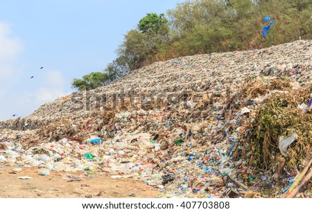 mountain of domestic garbage in landfill - stock photo