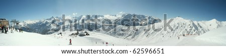 Mountain panorama.Alps.Skiers and slopes in area Zillertal - stock photo