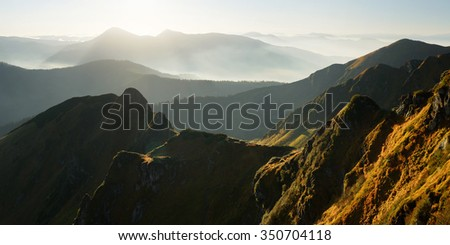 Mountain panorama. Beautiful backlight on the hills. Autumn landscape in the morning. Carpathians, Ukraine, Europe - stock photo
