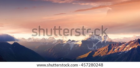 Mountain panorama during sundown. Beautiful natural panoramic landscape in the summer time - stock photo