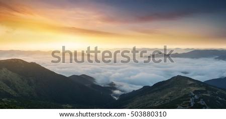 Mountain panorama during sunrise. Beautiful natural panoramic landscape in the summer time
