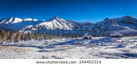 Mountain panorama in the high mountains in winter - stock photo