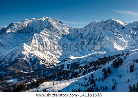 Mountain Peak and Ski Slope near Megeve in French Alps, France - stock photo
