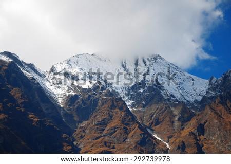 Mountain peak in a fog, Nepal  Himalaya - stock photo