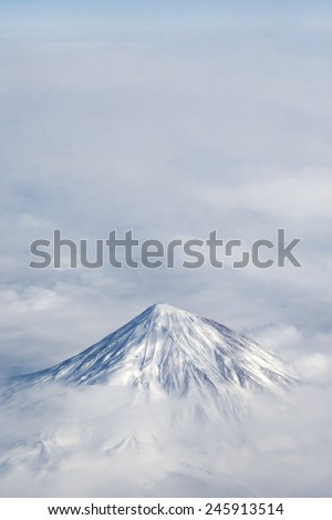 Mountain peak in the clouds. - stock photo