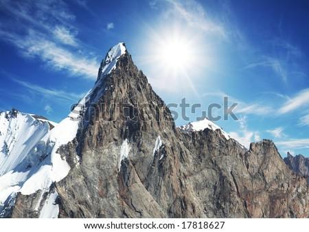 Mountain peak on sunny background - stock photo
