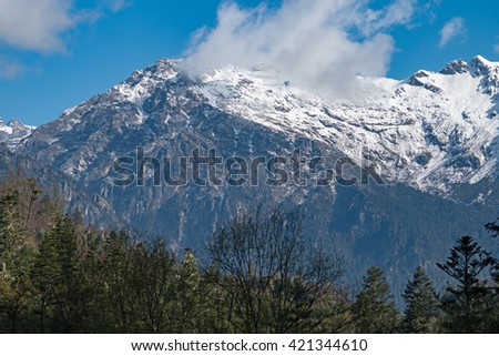 mountain peak on the road under snow, Sichuan, China - stock photo