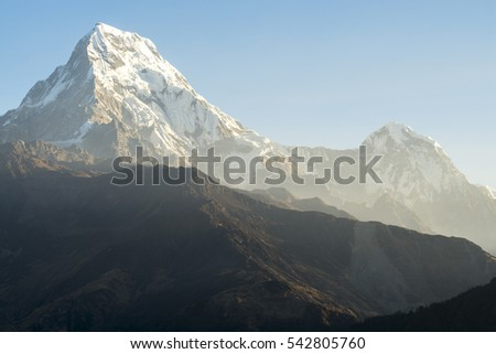 Mountain peak with morning light in blue sky background