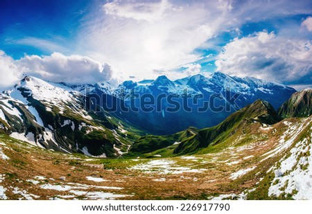 Mountain peaks covered with snow  - stock photo