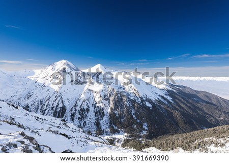 mountain peaks covered with snow illuminated by a bright sun