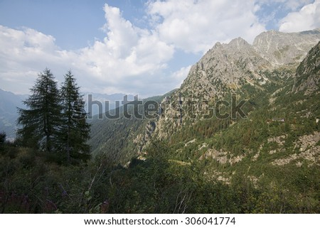 Mountain peaks in the clouds - stock photo