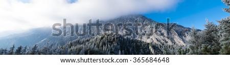 Mountain peaks, in winter season - stock photo