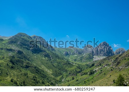 Mountain peaks meadows and forests in Grana Valley, Cuneo, Piedmont, Italy.