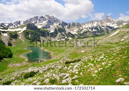 Mountain peaks with lake - stock photo