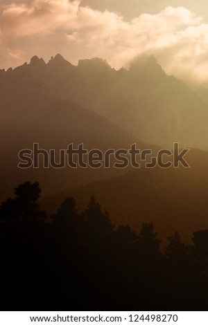 Mountain range at sunset - stock photo