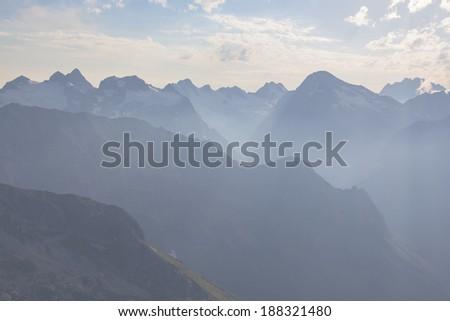 mountain range in a blue mist - stock photo