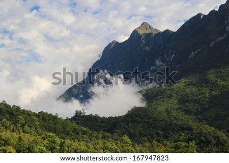 Mountain range in Chiang Mai, Thailand ( Doi Luang, Chiang Dao, Chiang Mai), Landscape of big rock mountain with mist and blue sky, adventure and travel natural forest in Thailand