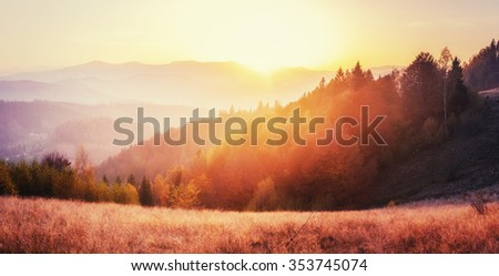 mountain range in the Carpathian Mountains in the autumn season. Fantastic sunset. Ukraine, Europe. - stock photo